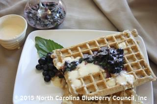 image Blueberry-Basil Compote over Blueberry Waffles with Orange Cheesecake Drizzle